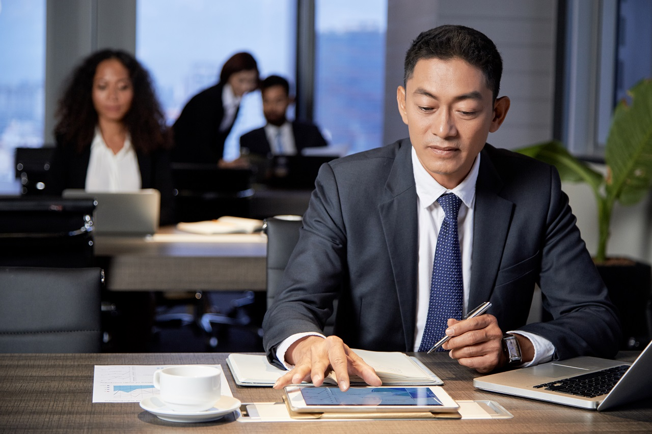 A businessman working in his office in an industrial park