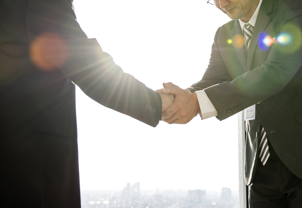 A business owner and an investor shaking hands