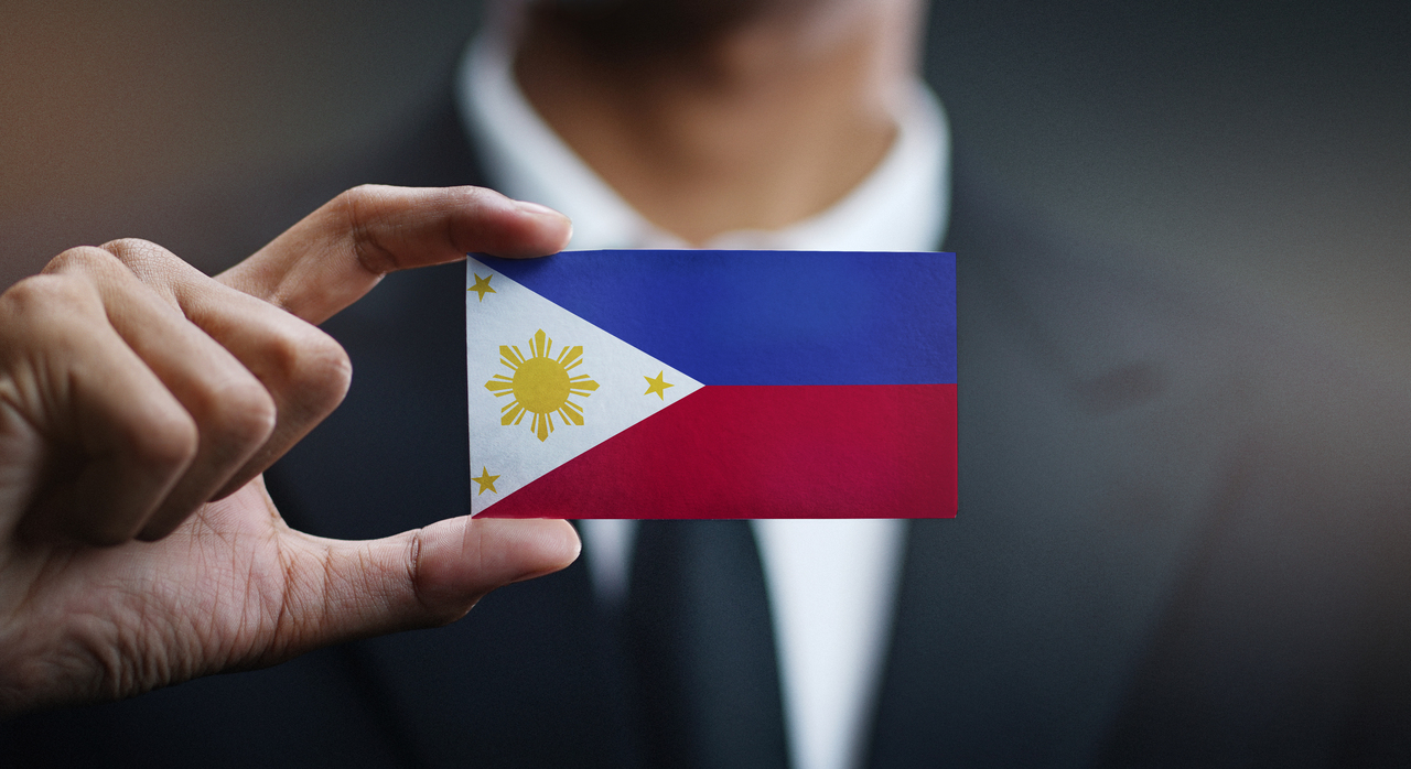 A foreign investor holding the Philippine Flag