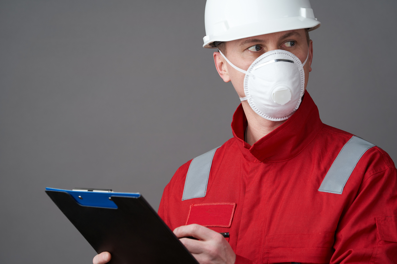 An engineer wearing a face mask at work