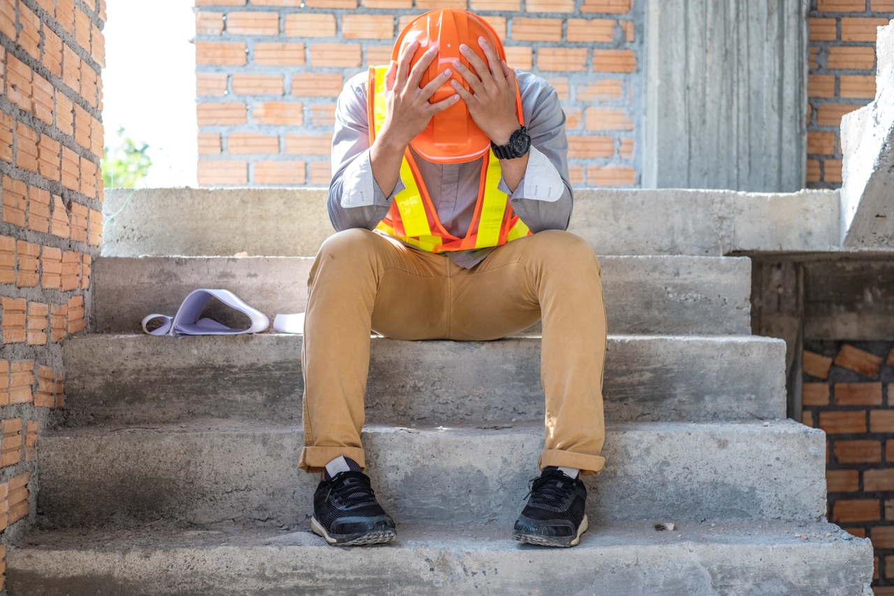 A stressed construction worker