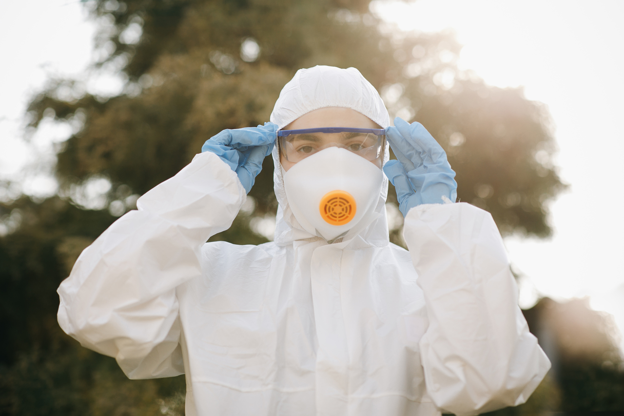 An employee wearing a full protective suit at work