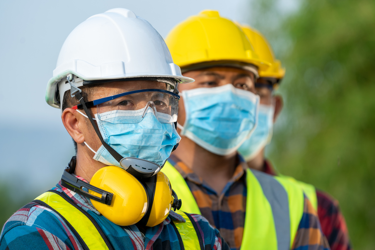Employees wearing protective gear