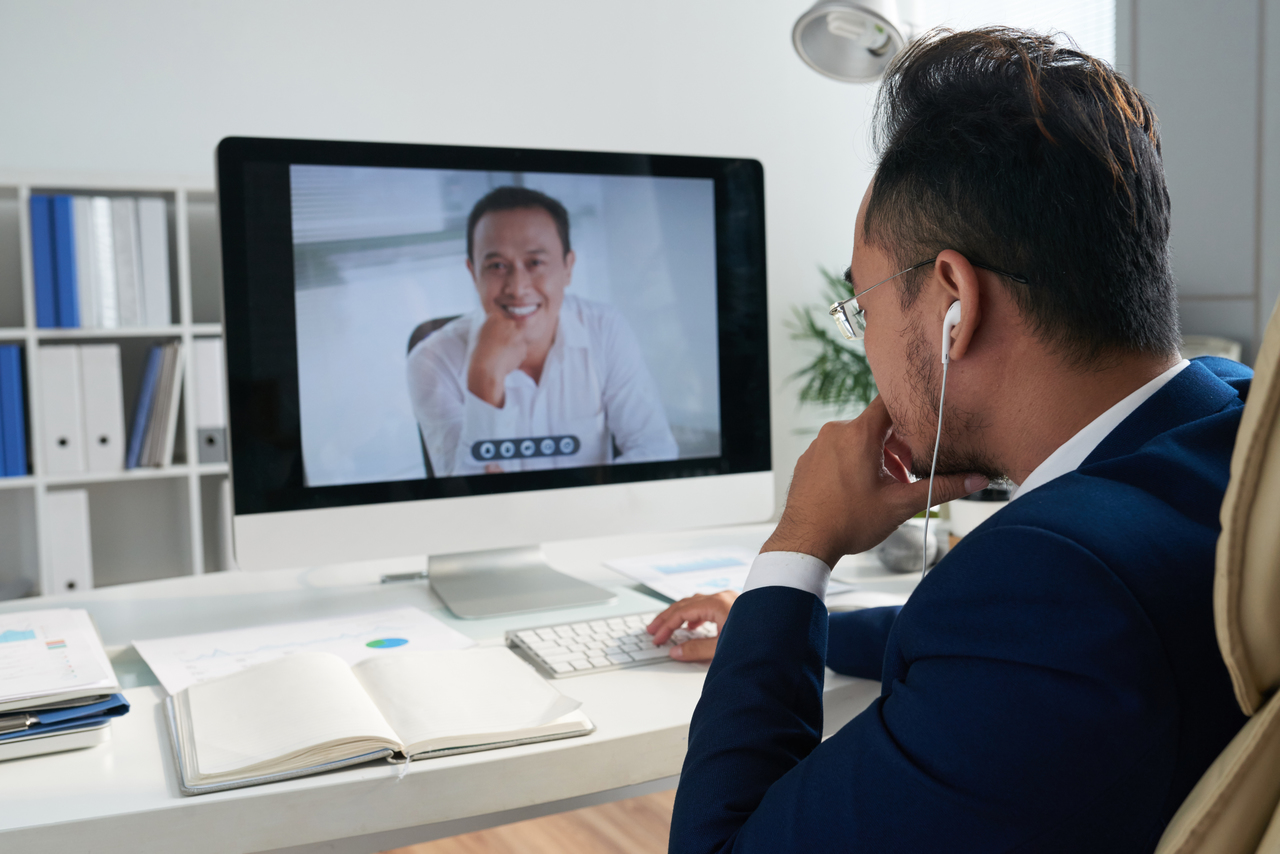 A man having an online meeting