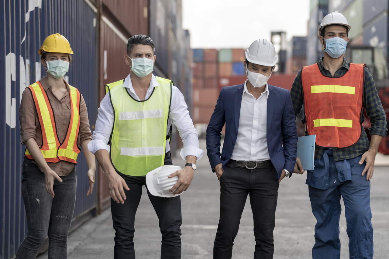 Warehouse workers in PPE