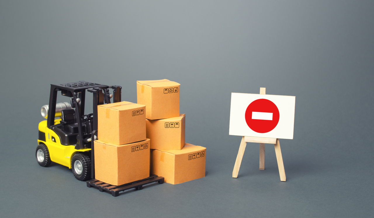 A forklift with a no entry sign beside it