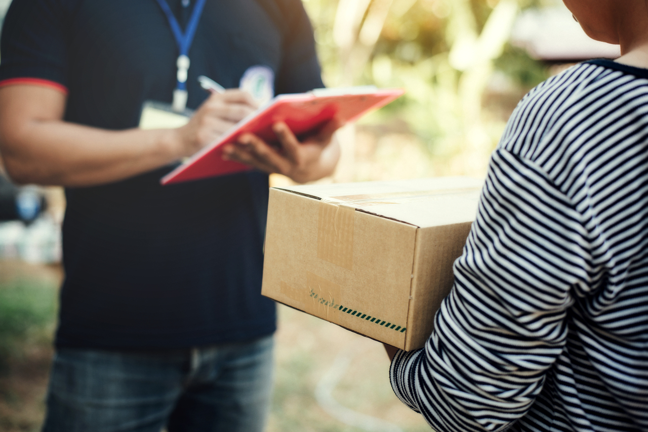 A man delivering an e-commerce package